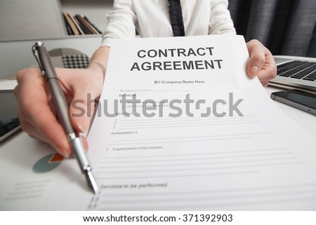 Business woman signing the contract document - stock photo