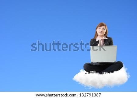 Business woman sit on cloud and use laptop over sky. - stock photo