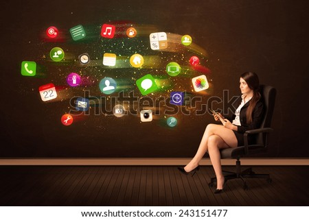 Business woman sitting in office chair with tablet and colorful app icons concept on background - stock photo