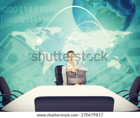 Business woman sitting in office, holding briefcase and looking at camera on abstract business background. Elements of this image furnished by NASA - stock photo