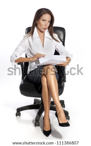 Business woman sitting on chair, holding document,  isolated on white background - stock photo