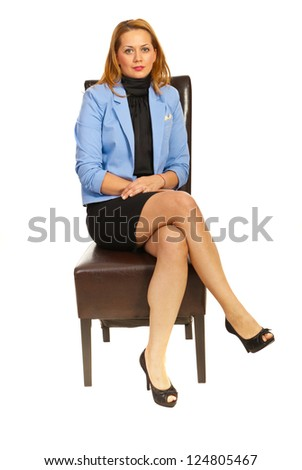 Business woman sitting on chair isolated on white background - stock photo