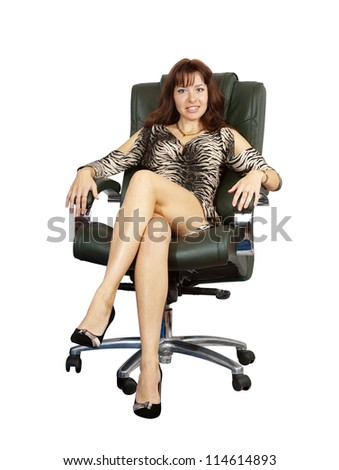 Business woman sitting on luxury office armchair. Isolated on white background - stock photo