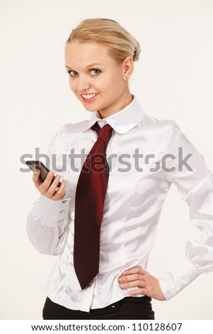 Business woman smiling with a phone in your hand - stock photo