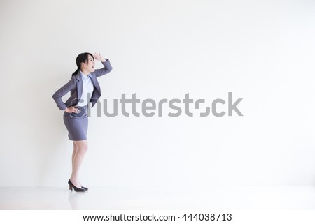 business woman stand and look something with white wall background, great for your design or text, asian - stock photo
