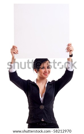 Business woman standing and holding a white empty billboard - stock photo