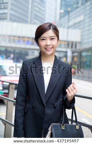 Business woman standing at outdoor - stock photo