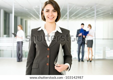 Business woman standing in front of her colleagues - stock photo