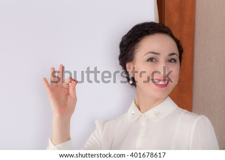 Business woman standing near the whiteboard. Photo can be used as a whole background. - stock photo