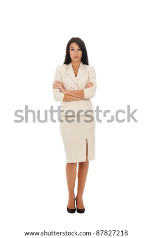 business woman standing with folded hands full length portrait. Isolated over white background - stock photo