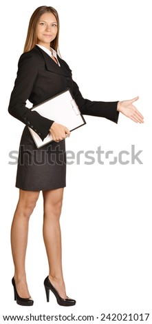 Business woman stretches out a hand of greeting. holds clipboard - stock photo