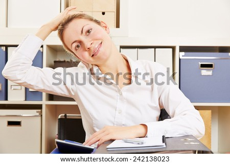 Business woman stretching her tense nape in the office - stock photo