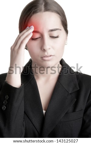 Business woman suffering from an headache, holding her hand to the head - stock photo