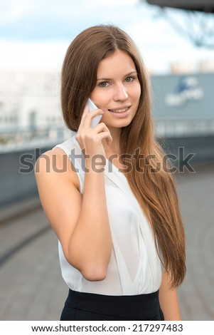 business woman talking mobile phone - stock photo