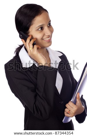 Business woman talking on cell phone - stock photo
