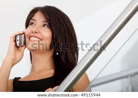 Business woman talking on the phone at the office - stock photo