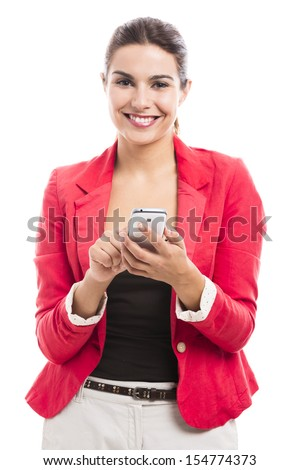 Business woman texting someone, isolated over a white background - stock photo