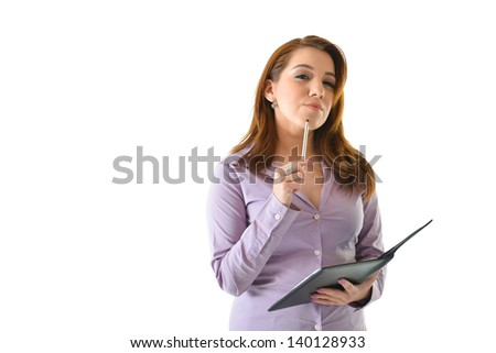 Business woman thinking of ideas with pen on chin and squinting eyes - stock photo