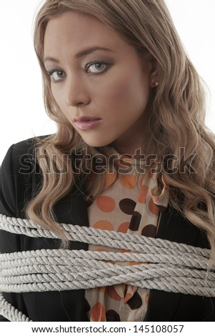 Business woman tires up at work not looking to happy - stock photo