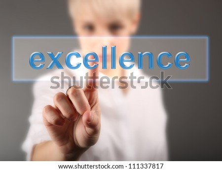 Business woman touching screen with Excellence sign - finance concept - stock photo