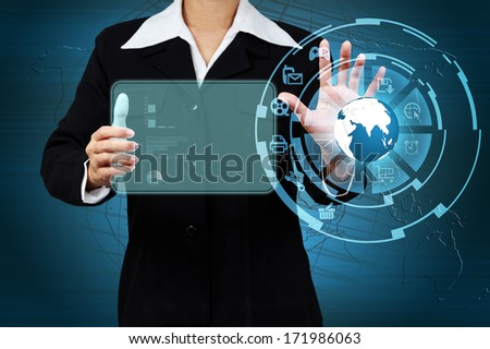 Business woman touching the globe and icon application on virtual screen. Concept of online business. - stock photo