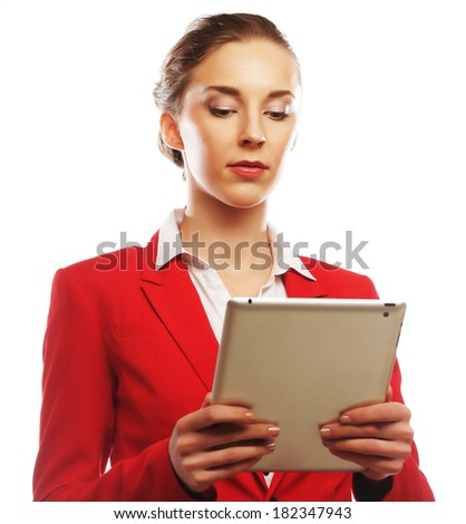 business woman uses a mobile tablet computer - stock photo