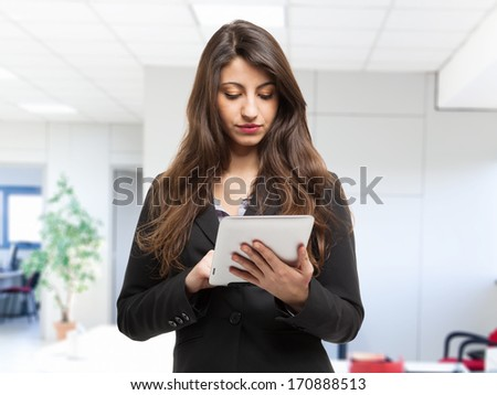 Business woman using a tablet computer - stock photo