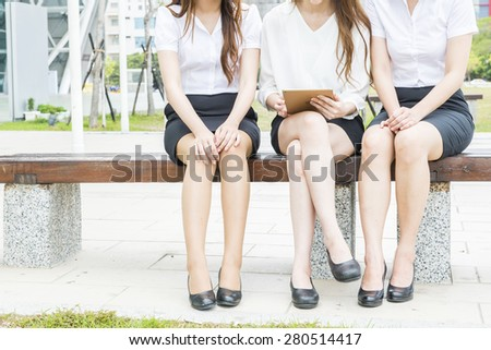 Business woman using a variety of mobile devices, mobile phones, smart watches, tablet, computer - stock photo