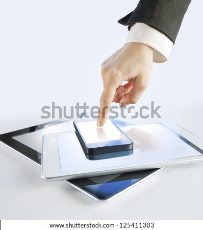 business woman using different types of digital tablet. businesswoman touching a modern electronic digital tablets - stock photo
