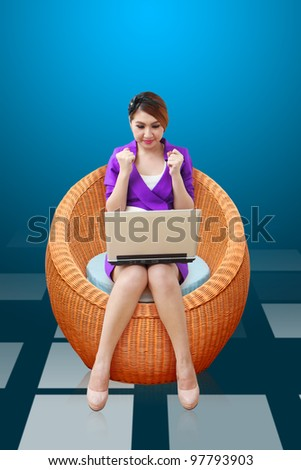 Business woman using notebook computer on the Chair - stock photo