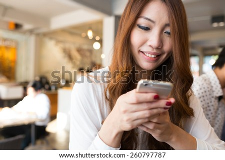 Business woman using smartphone in the cafe, Modern city's lifestyle - stock photo