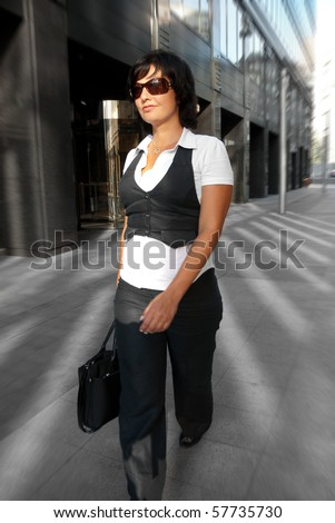 Business woman walking down the street - stock photo