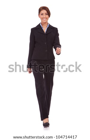 Business woman walking in full length on white background - stock photo