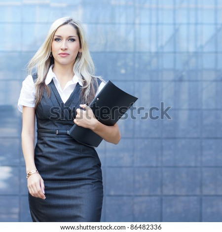 Business woman walking in the street - stock photo