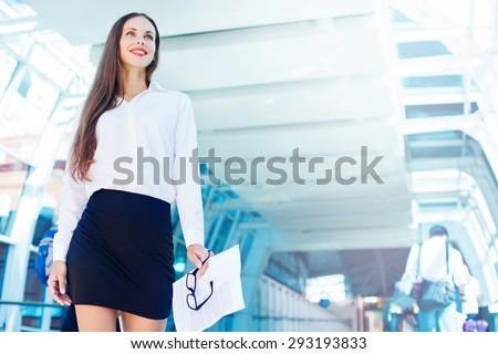 business woman walking the corridor - stock photo