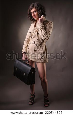 business woman wearing a raincoat - stock photo