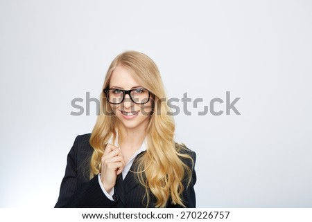 Business woman wearing glasses isolated over a white background - stock photo