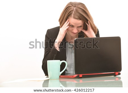 Business woman who is frustrated or confused while looking at computer and getting bad news - stock photo