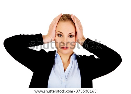 Business woman with a huge headache holding head - stock photo