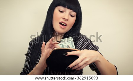 Business woman with a purse of money - stock photo