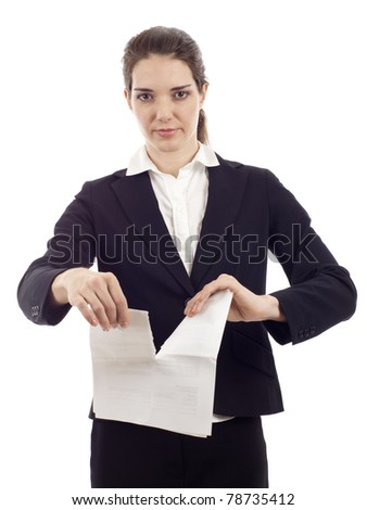 Business woman with a serious expression as she tears up a contract isolated over white