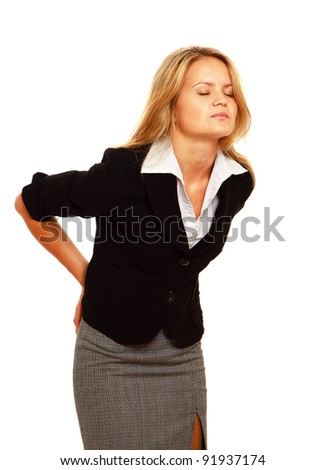 Business woman with back pain holding her aching hip, isolated on white background - stock photo