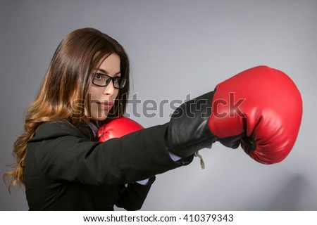 business woman with boxing gloves - stock photo