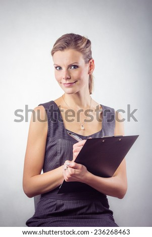 Business woman with clipboard and pen Isolated On White Background - stock photo