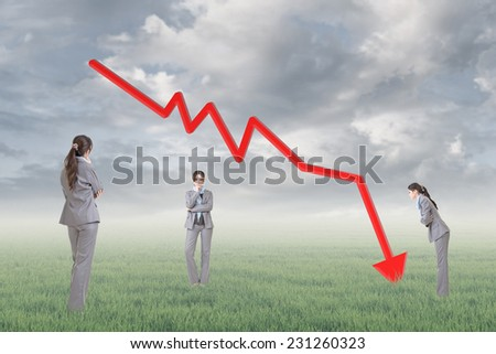 Business woman with downward arrow, concept of decrease, down, negative etc.  - stock photo