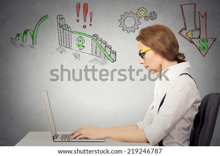 Business woman with glasses working on computer, anticipation of financial crisis, bad, poor economy, grey wall background. Corporate employee thinking, making decisions. Face expressions - stock photo