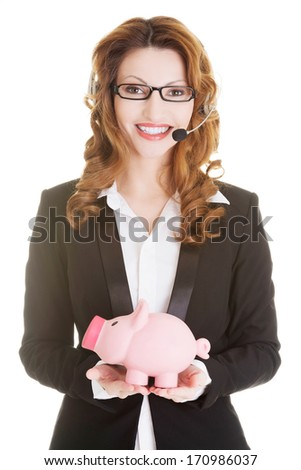Business woman with headset holding piggy bank , isolated. - stock photo