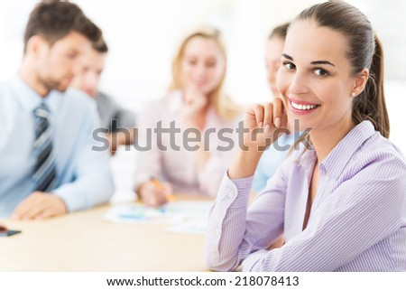 Business woman with her team  - stock photo
