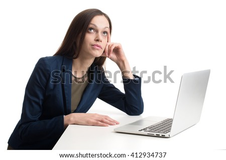 business woman with laptop daydreaming. Studio shot - stock photo