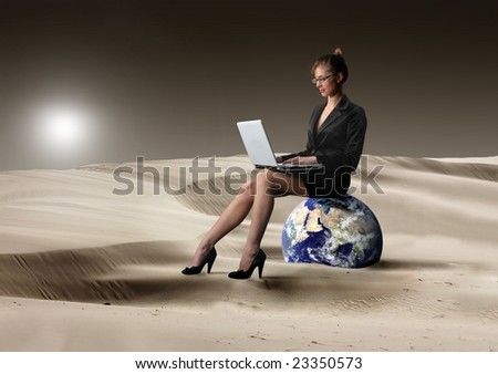 business woman with laptop in the desert - stock photo